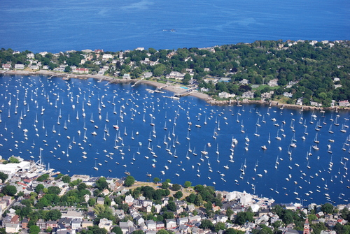Summertime view of Marblehead Village, with Marblehead Harbor, and then Marblehead Neck in background
