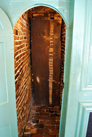 The Dining Room's Escape Hatch, hidden behind a verdigris-painted panel, which was installed in 1692 by John Turner, Jr. (who we can presume was the restless host of my fantasy).