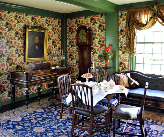 Living Room, or Main Hall, with window facing Salem Harbor. As the wealth of the occupants increased, the principal rooms in the House were redecorated. The decor in the Main Hall dates from 1725, when John Turner Jr. added Georgian-style paneling and double-sash windows.