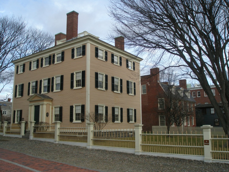 Benjamin Hawkes House, adjacent to The Custom House. Construction was begun in 1780, but suspended until boat builder Hawkes acquired it in 1801, and then renovated and completed the structure. The brick house behind the Hawkes House is Derby House, the oldest surviving brick house in Salem, erected in 1762