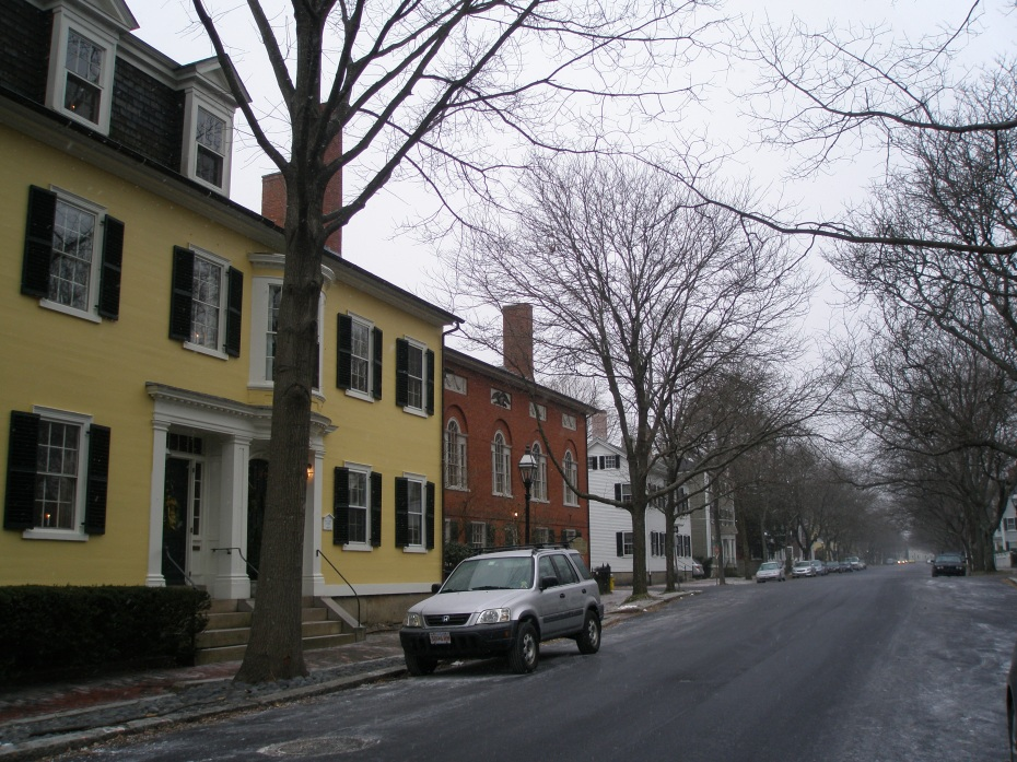 The low-numbered-end of Chestnut Street, as seen on the cold and stormy afternoon of January 28, 2013. The Deacon John Stone House is the yellow double structure. Hamilton Hall is the adjacent brick building.