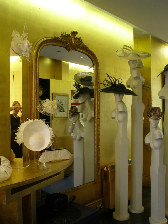 Inside Philip Treacy's London shop, with a be-pearled me captured in the mirror.