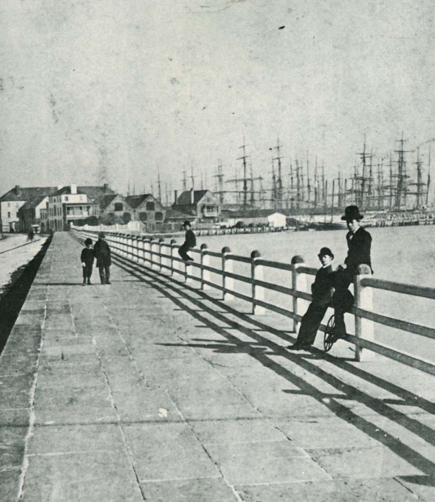 The Seawall Promenade on the Battery, in Yesteryear, with Charleston's busy Harbor in the background. Image courtesy of CHARLESTON COME HELL OR HIGH WATER, by Whitelaw & Levkoff.