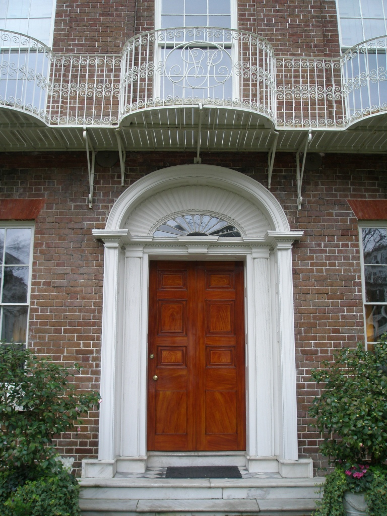 Front Entry to the Nathaniel Russell House, with the owner's initials filigreed into the wrought iron balcony.
