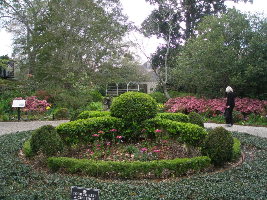 Donn inspects the Garden at the Nathaniel Russell House.