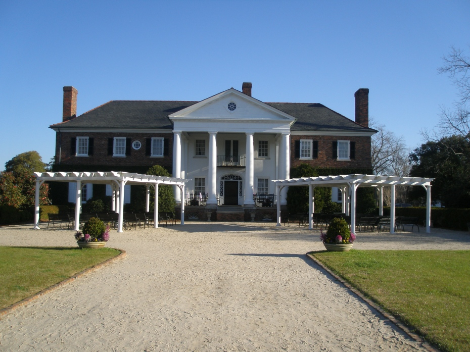 Front of Main House. Arbors and Folding Chairs at the ready: this is a Major Venue for wedding celebrations.