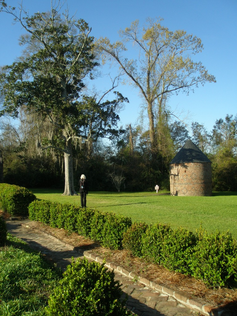 Donn inspects the Smoke House, which is the oldest structure at the Plantation