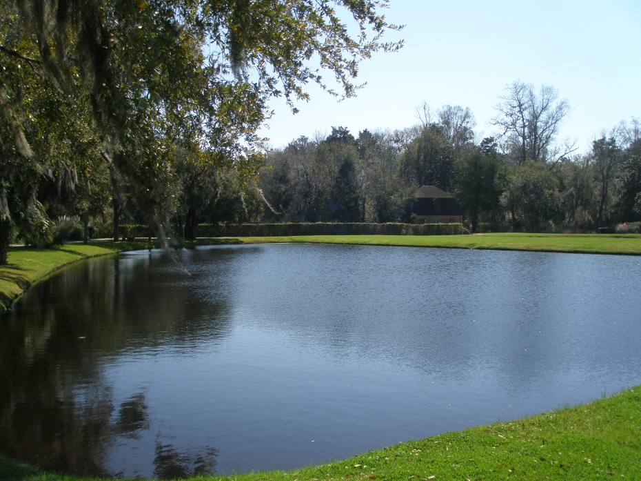 View from the base of one of the Butterfly Lakes toward the Spring House/Plantation Chapel.