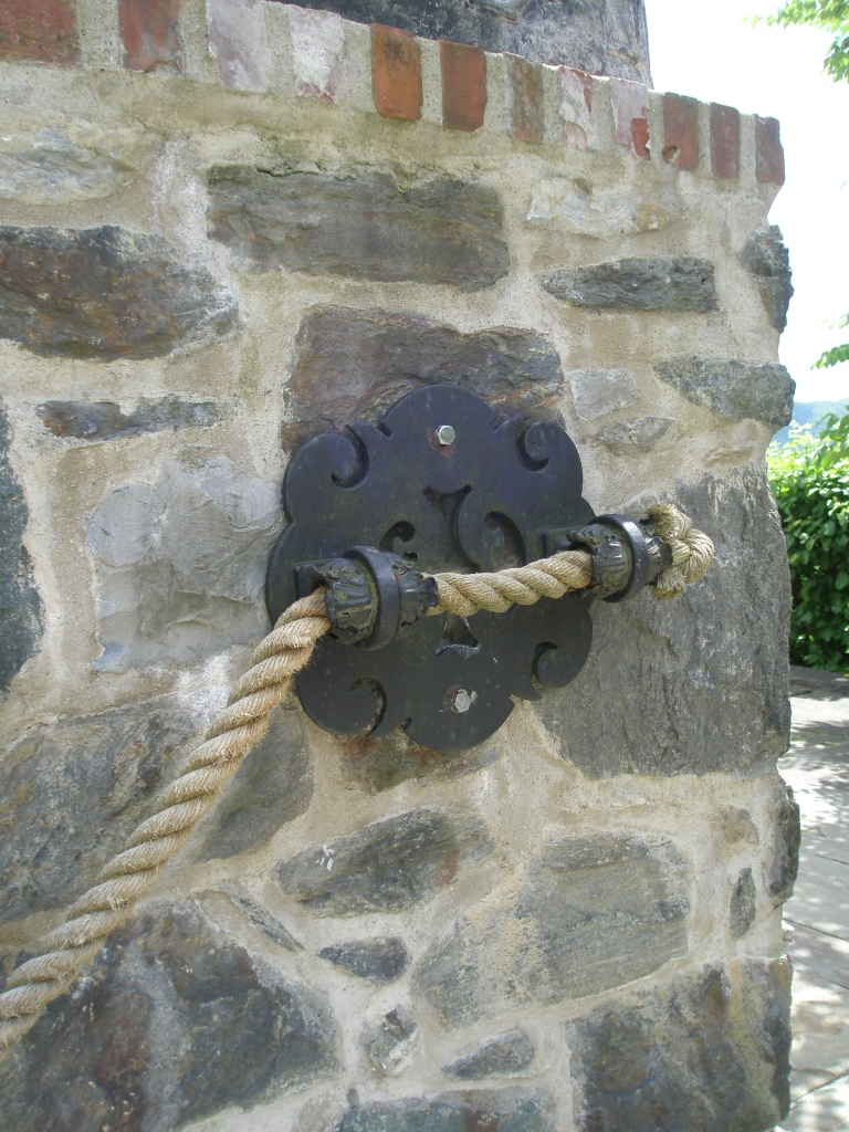 Rope Bannister and Ornate Steel Medallion near the Top Lawn