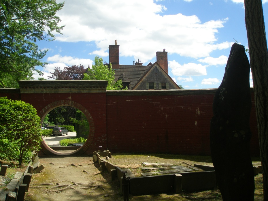 View from the Chinese Garden, out through the Moon Gate, toward my Trusty Chariot, and the Choate House.