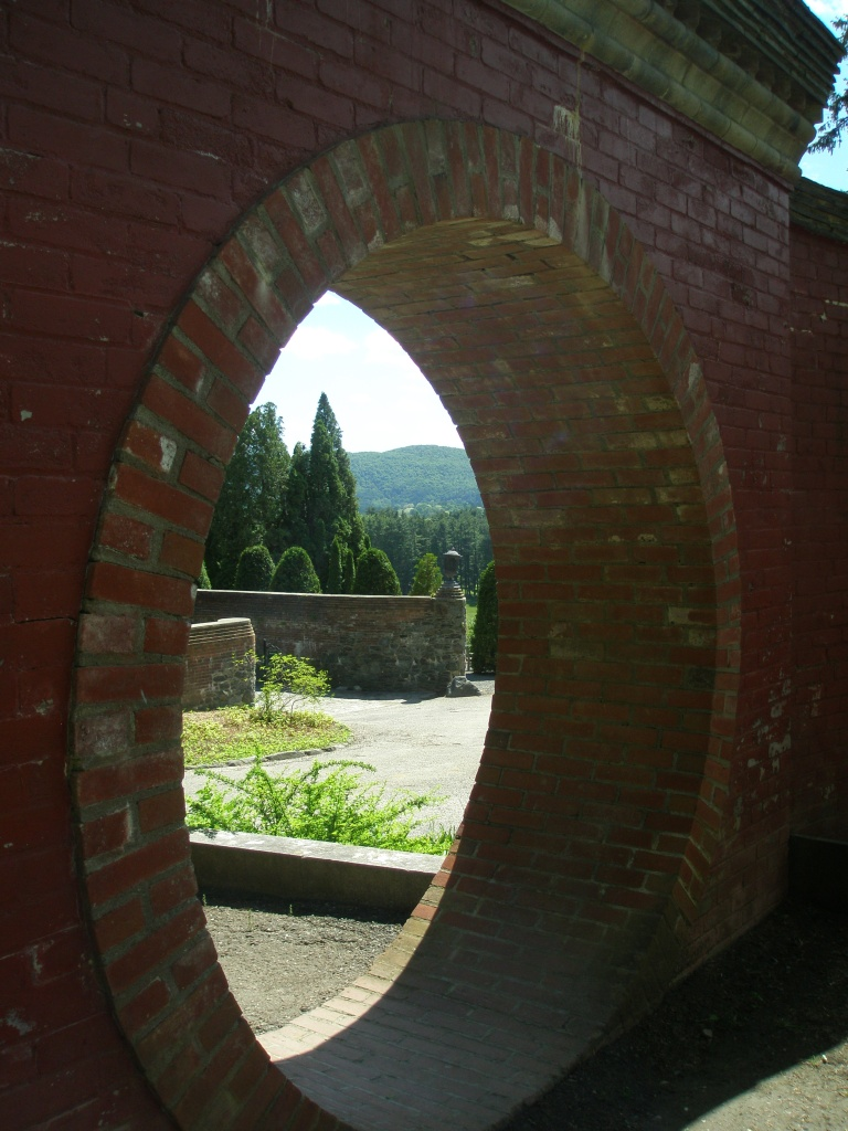 View through the Moon Gate, out toward the Arborvitae Walk, and the Western hills.