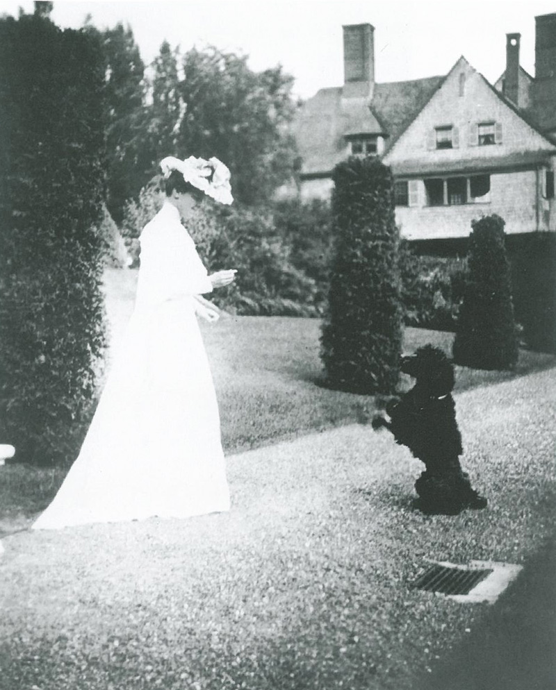 Mabel Choate and her pooch on the newly-planted Arborvitae Walk. Image courtesy of FLETCHER STEELE, LANDSCAPE ARCHITECT, by Robin Karson.