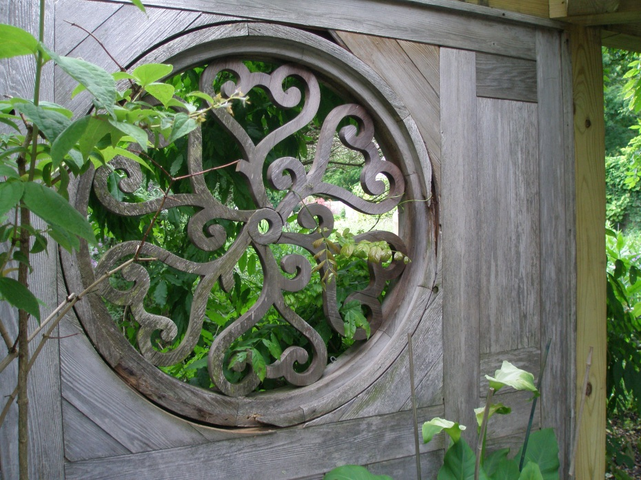"CLAIR VOIE: a grille set into a wall, which allows a ""clear view"" of the Enclosed Flower Garden."
