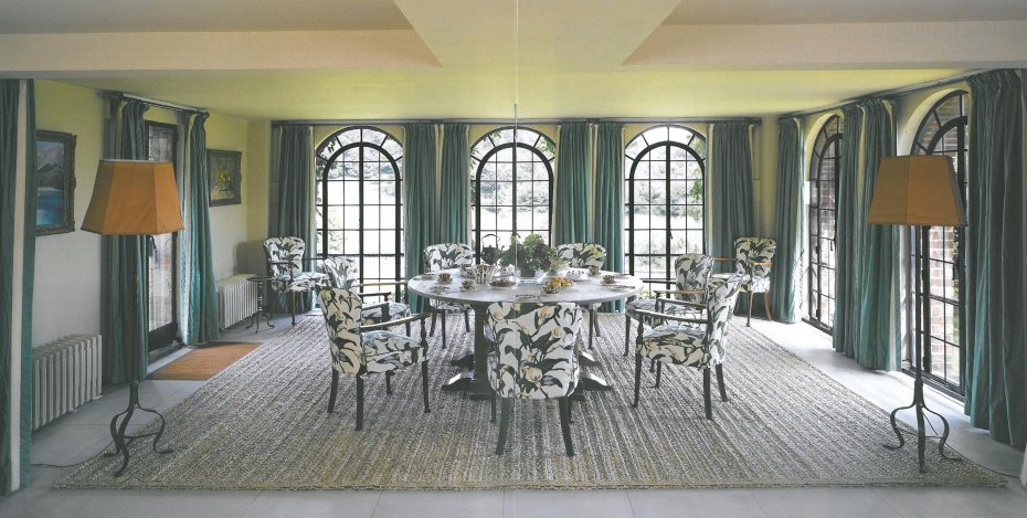 "I adored the basement-level Dining Room, which has windows on three sides. The sea-grass carpet is woven specially for this space and the room is suffused with the fresh aroma of that grass. This rug is regularly replaced, so as to maintain the clean smell that Winston enjoyed. The vivid glazed chintz covering the chairs is the same pattern--""Arum Lily""--that has always decorated the room."