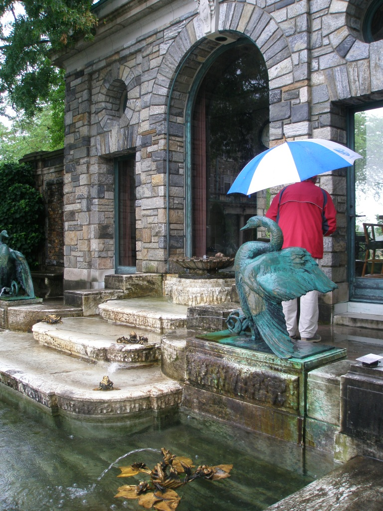 At the Tea House, a pool with more fountains by F.M.L.Tonetti. Mr. Onofrio's umbrella is keeping him only partially dry.