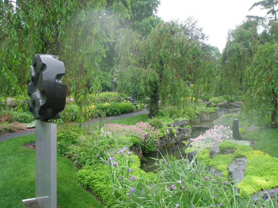 ..rain, Rain, RAIN...in the Brook Garden. Isamu Noguchi's BLACK SUN (1960-63) is mounted on a slim, gray pedestal