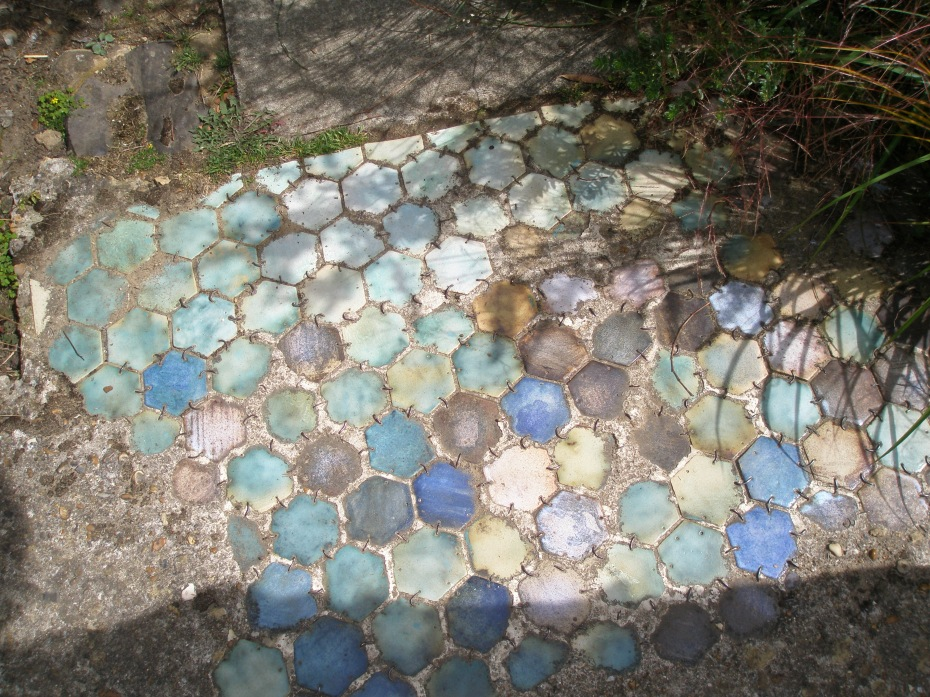 Bathroom Tiles are re-purposed, as Paving on a path