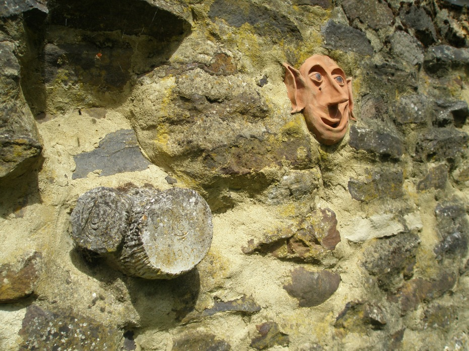 Faux Bois, and a Garden Sprite, mortared into a Ruin Wall