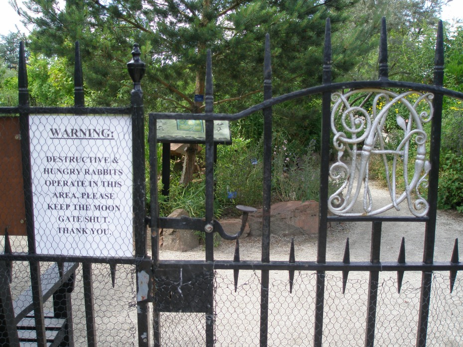 At the Moon Gate Entrance to The World Garden: Beware the Hungry Rabbits. The United Kingdom is just inside the Gate. The British Isles beds contain Scottish Caledonia Pine and Butcher's Broom