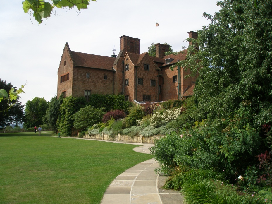 """The view from the Terrace Lawn, up toward the back of the House. After Churchill bought Chartwell, his architect Philip Tilden built a new wing, which extended out into the garden. The 3 stories of this addition contained a Dining Room on the garden-level basement, a Drawing Room on the ground floor, and a barrel-vaulted bedroom for Clementine on the first floor. Ever-dramatic, Churchill called his addition """"my promontory."""""""