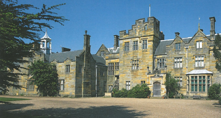 The New House at Scotney Castle was built in an Elizabethan-Revival Style, from 1837--1843. On the Entrance Front, a battlemented tower dominates. The walls are built with a striated, golden sandstone, which was dug from the quarry that's immediately below the House. Image courtesy of The National Trust.