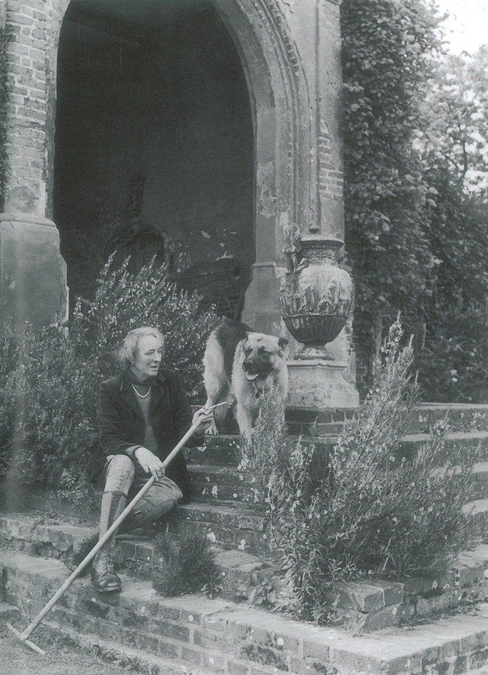 Vita Sackville-West, after WWII, on the Tower Steps, with Rollo. Image courtesy of The National Trust.
