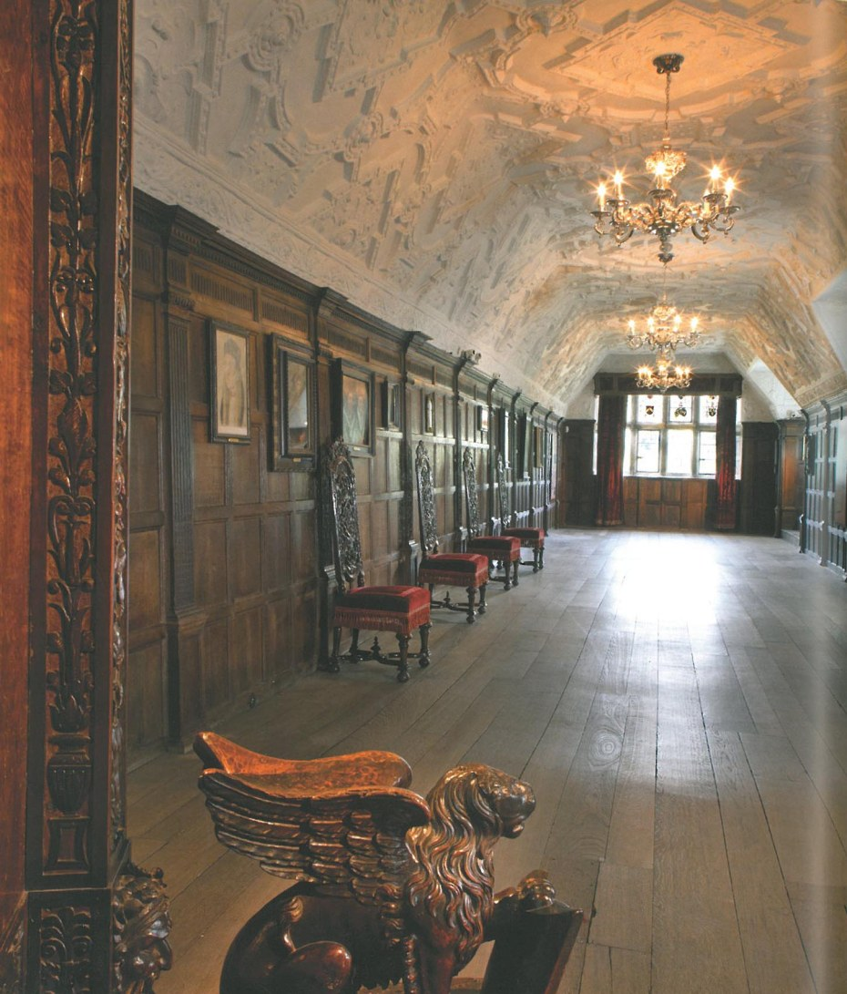 The Long Gallery is more than 98 feet long and runs the entire width of the building. This was added by Thomas Bullen in 1506, and was used for entertaining, displaying art, and taking exercise during inclement weather. The paneling is Elizabethan, and the ceiling is a 16th century style reproduction made for Astor. Tradition says that  Henry VIII held Court in the alcove at the far end of the Long Gallery when he visited Hever Castle. Image courtesy of Hever Castle.
