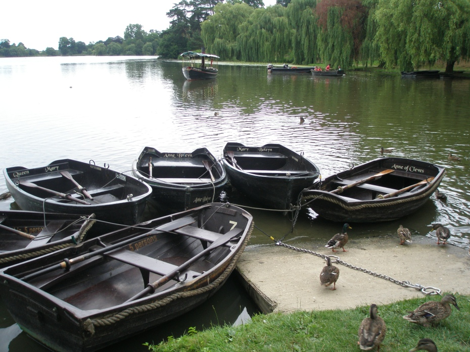 """Landing Stage at the east end of the Lake. One of the rowboats is christened """"Anne of Cleves,"""" to honor Henry VIII's fourth wife. This Anne can perhaps be considered to be the most fortunate of Henry's spouses; their union was annulled after 6 months because Henry found her, his """"Flanders Mare,"""" unappealing. As part of the divorce settlement, she was given Hever Castle. Eventually, Anne of Cleves and Henry enjoyed a platonic friendship: he called her """"sister."""""""