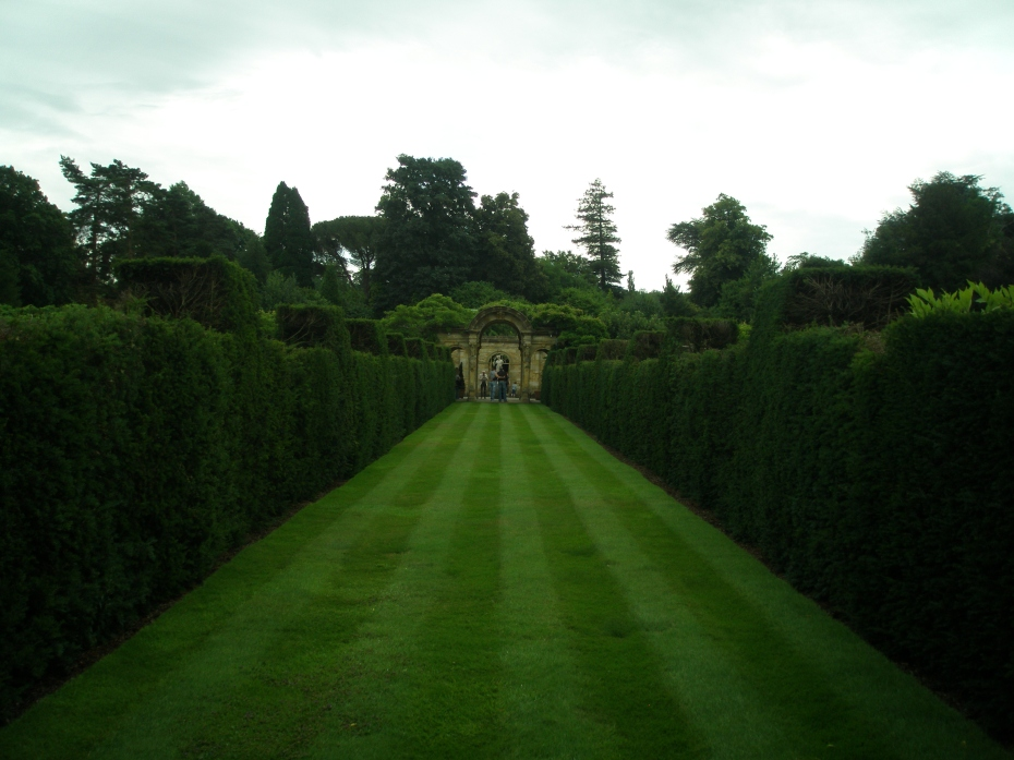 A cross-wise path bisects the long green of the Italian Garden