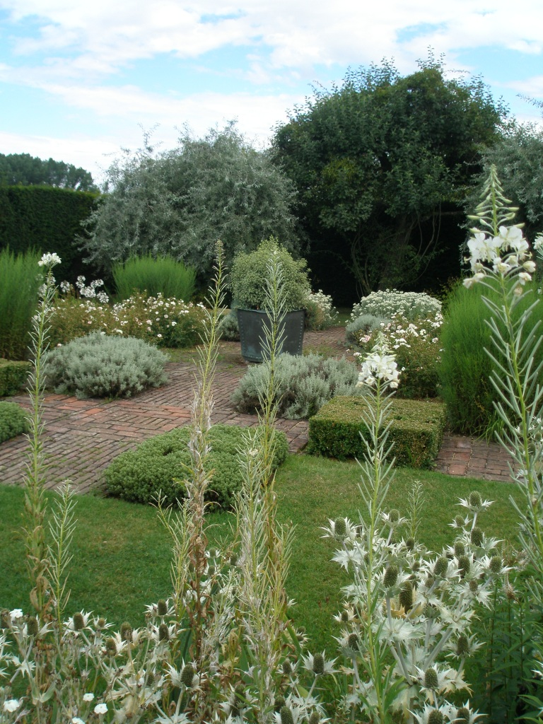 The Grey & White Garden's elegant geometry is softened by billowing flowers and foliage.