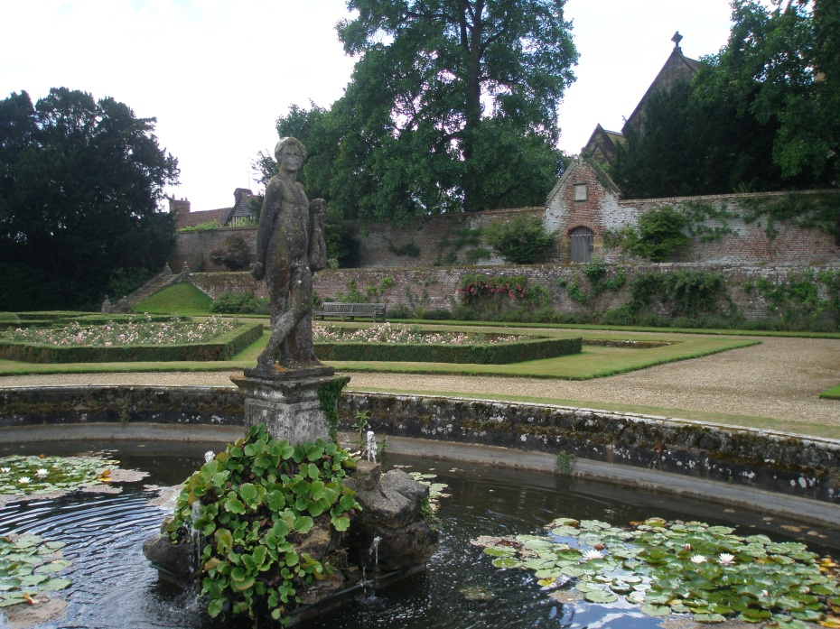 The fountain at the center of the Italian Garden. The statue is of a young Hercules, and was moved to Penshurst from Leicester House, in London. The gabled roofs of similarly-named Leicester Square, which include a 14th century Guildhouse, are visible to the left, behind the high wall.