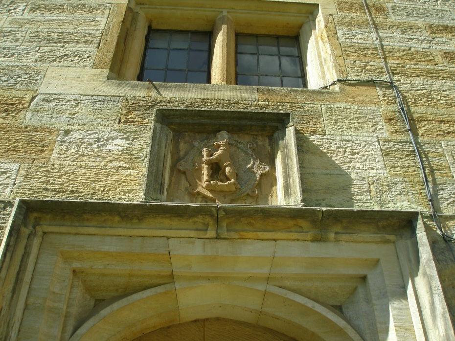 Another Dudley family Bear With Ragged Staff, this one carved atop a doorway.