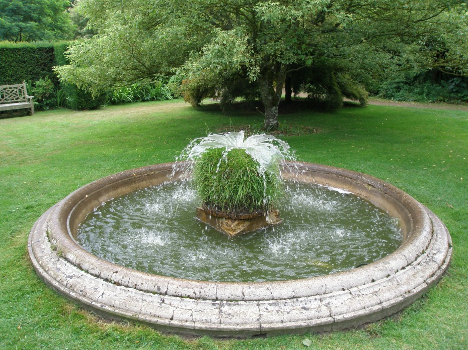 The Oriental Garden is centered upon a pool, with an unusual grass fountain.