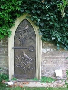 A bronze Door to Nowhere, on the Rose Garden Wall