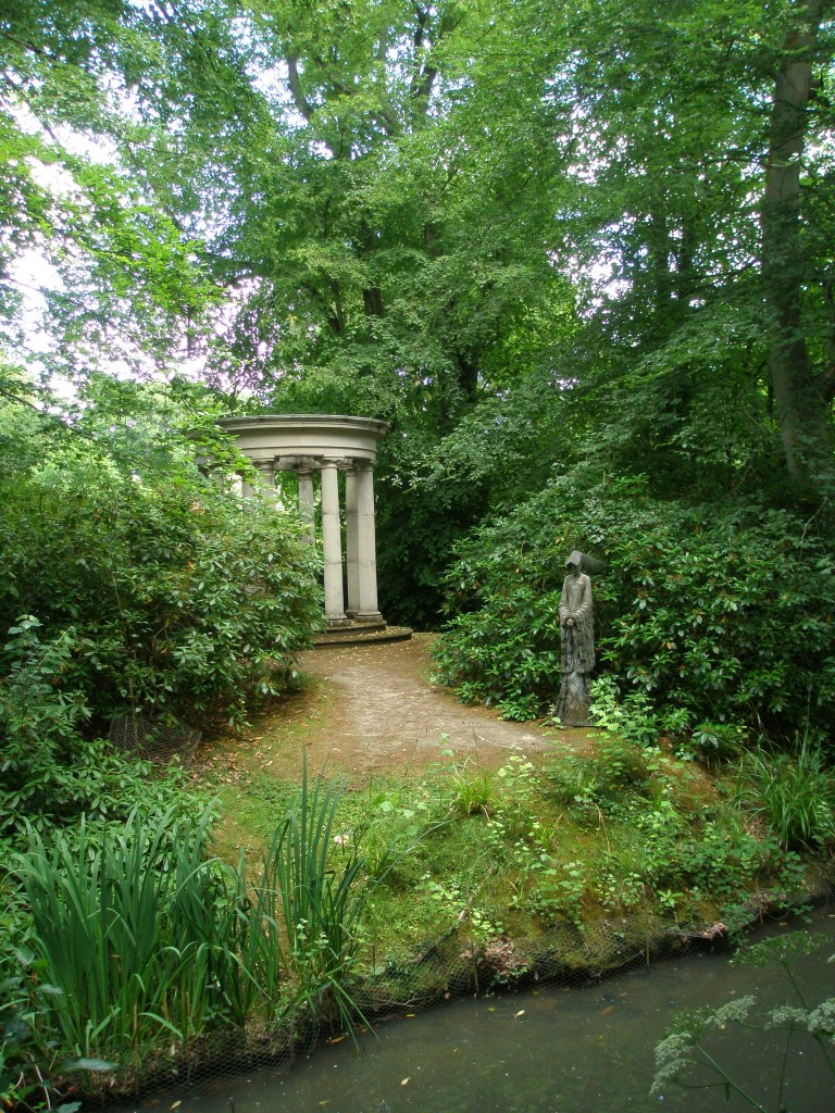 On the Island: a Classical Temple, and a statue of Anne Boleyn. The Boleyn family owned Pashley in the 16th century, and used it as a hunting lodge.