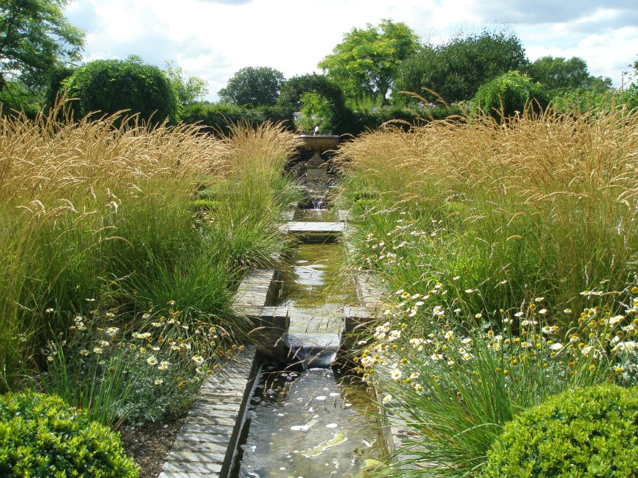 An elegant Rill, surrounded by grasses. I'd actually like to lift this in its entirety, and transplant it into my New Hampshire garden.