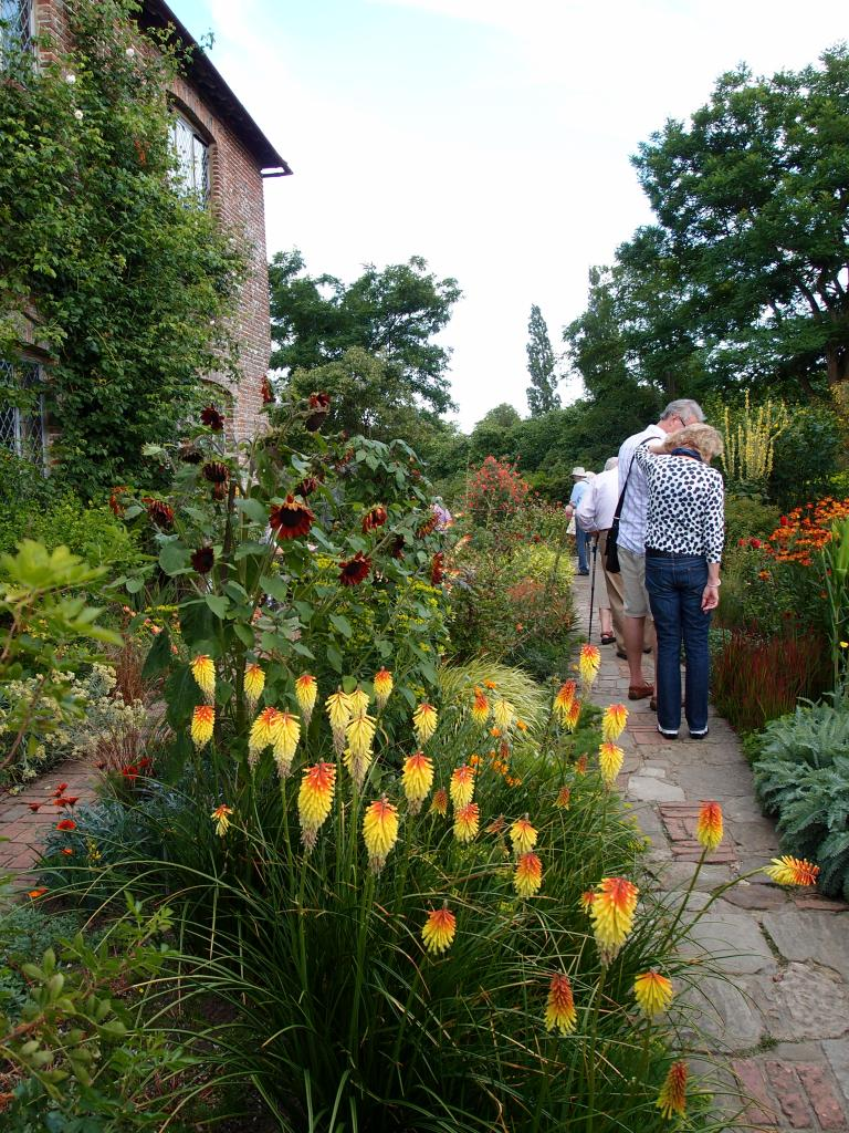 Leaving the Rose Garden, we entered the small Cottage Garden, which is always planted with rich orange, red and yellow flowers.