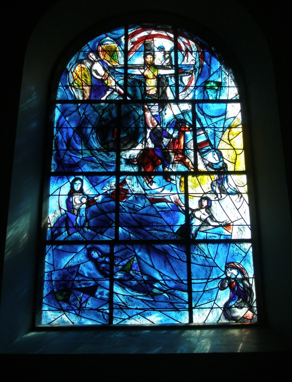 Chagall's Memorial Window, at All Saints Church, in Tudeley. The blue-ish light that's reflected against the walls around the lower portions of the window seems to splash real sea-spray into the air.