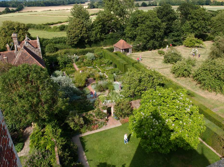 Looking North. The White Garden. Just to the right of the high hedge is a Boathouse, which is placed on the Northwest corner of the Orchard, at the end of the Moat.