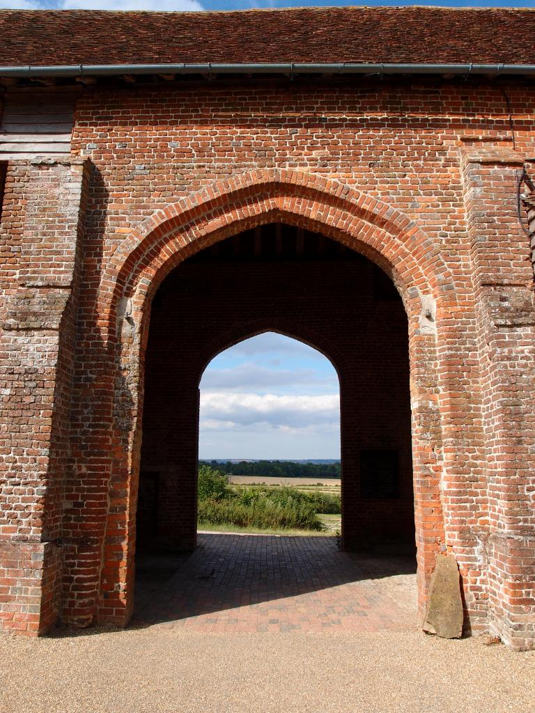 We rejuvenated ourselves with strong tea and sweet scones, and then took a last look at the beautiful countryside...framed by this arch in the Elizabethan Barn.