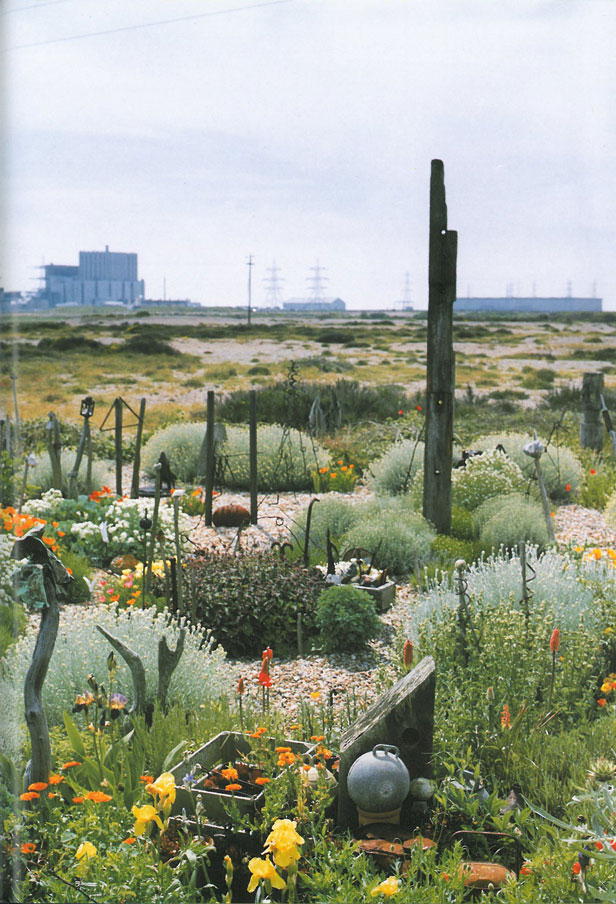 Jarman's back garden, with the Dungeness Nuclear Power Station in the not-too-far-distance. Image courtesy of Estate of Derek Jarman.