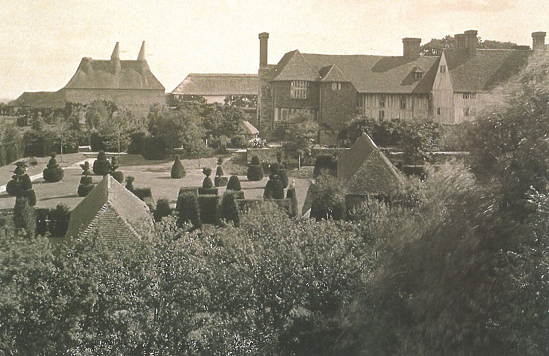This is what the Topiary Lawn looked like in 1918, when Christopher Lloyd's mother Daisy presided over a much-tidier Topiary World. Image courtesy of Great Dixter Charitable Trust.