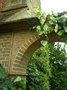 Lutyens embedded tiles, above his arch