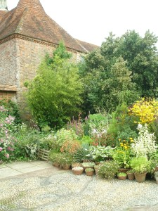 As with the front entry to the house, the Wall Garden is decorated with potted flowers.