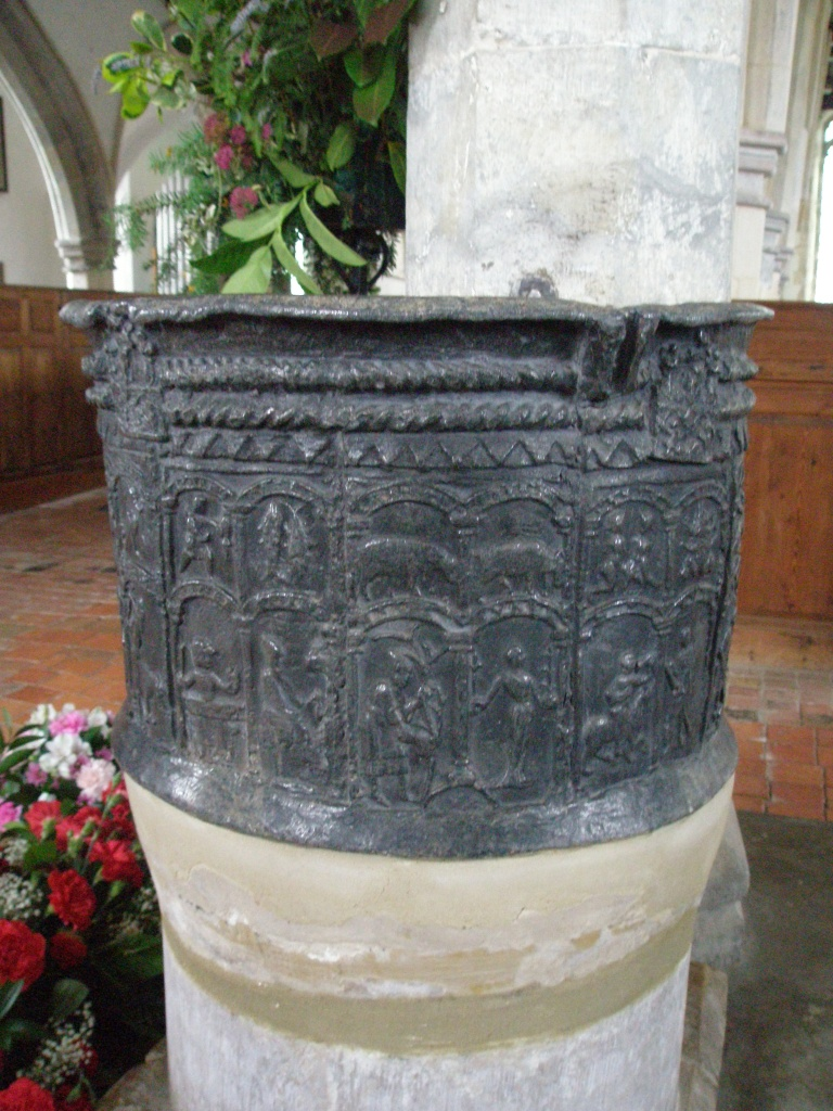 The Font is decorated with 12 panels showing the signs of the Zodiac, which are accompanied by images of the typical labors of each month.