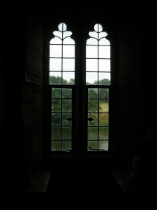 Delicately-detailed windows in the Queen's Room look out over the moat.