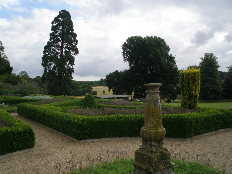 A mossy, marble column is mounted at the center of the Parterre.
