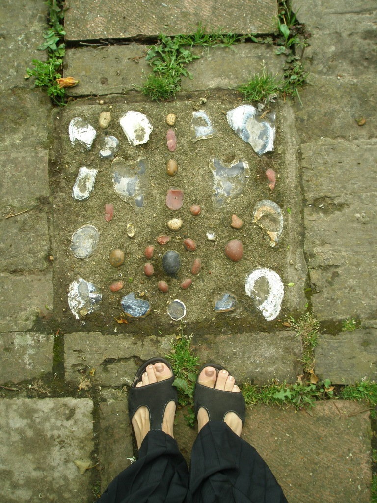 Nan's Toes! On the shell-decorated pavements in the Walled Gardens.