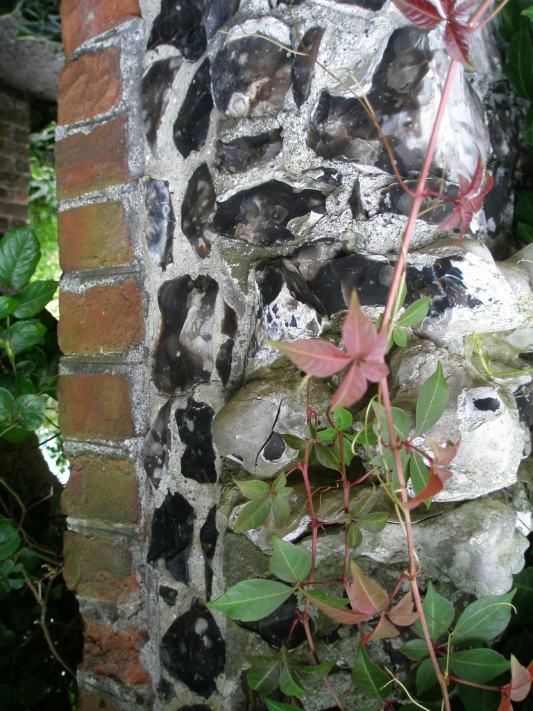 A closer look at the split-flint decoration on the Walled Garden arch.