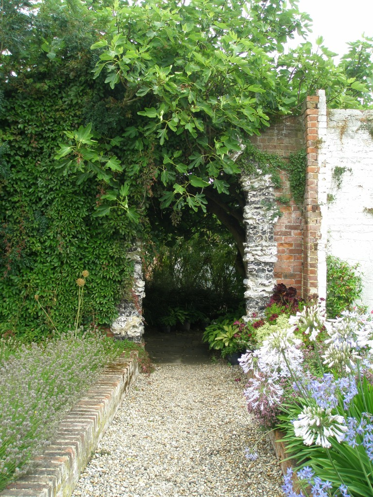 One of the rare curiosities in the Walled Garden is this flint-decorated archway.